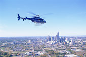 Helicopter flying over city