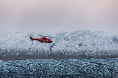 Helicopter flying, snow covered landscape, Iceland