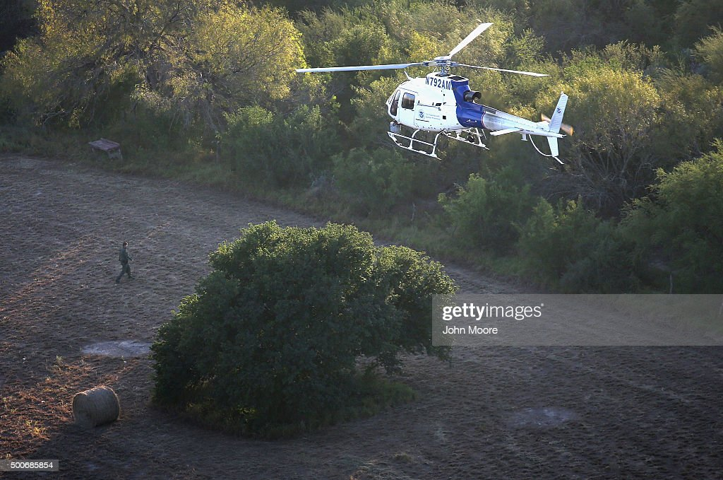 A helicopter from U.S. Air and Marine Operations (AMO), searches for undocumented immigrants near the U.S.-Mexico border on December 9, 2015 at near Mission, Texas. The number of migrant families and unaccompanied minors from Central America crossing into the U.S. has again surged in recent months.