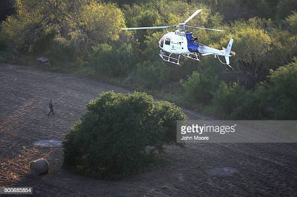 A helicopter from US Air and Marine Operations searches for undocumented immigrants near the USMexico border on December 9 2015 at near Mission Texas...