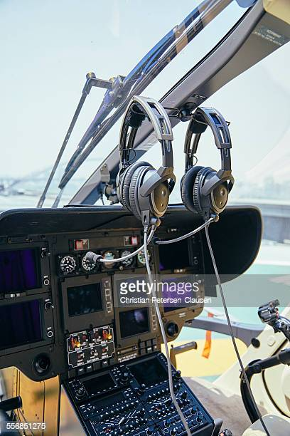 Helicopter glass cockpit with headphones