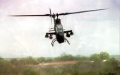 A US helicopter gunship which hit a T45 tank of Somali warlord Mohamed Farah Aidid flies over the capital during an attack by planes and helicopters...
