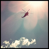 Helicopter hovering overhead