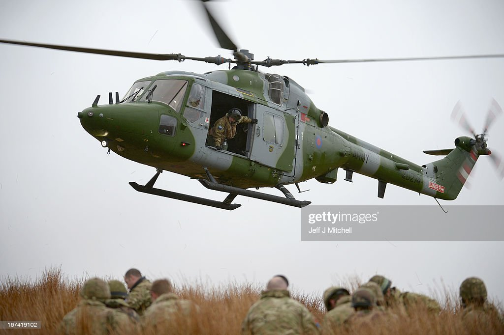 A helicopter hovers during a British And French Airborne Forces joint exercise on April 25, 2013 in Stranraer, Scotland. Exercise 'Joint Warrior' sees British and French airborne forces demonstrate their readiness to be deployed together as the 'Intermediate Combined Joint Expeditionary Force' ( i-CJEF) on contingency operations, ranging from disaster relief to war fighting.