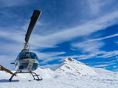 Helicopter in the alps in winter season