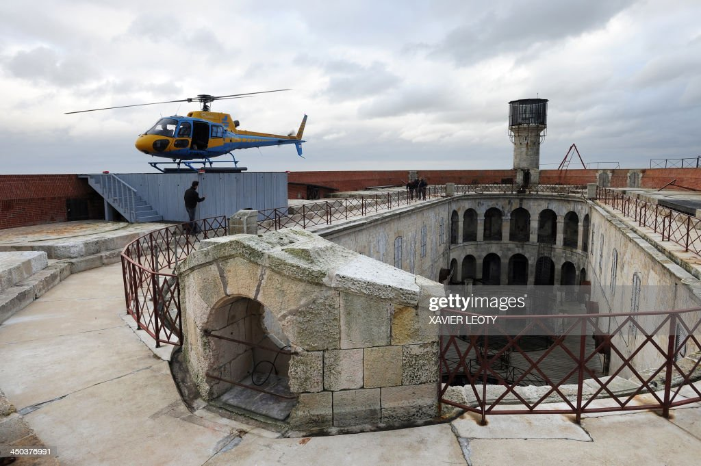 A helicopter is parked on Fort Boyard, a fort in the Atlantic Ocean off the coast of France, near La Rochelle, on November 15, 2013. The fort is the filming location for the TV gameshow 'Fort Boyard' and is undergoing renovations. Workers arrive on Monday morning by helicopter and leave on Friday evening. During the winter the renovations are on hold and will pick up again in March 2014.