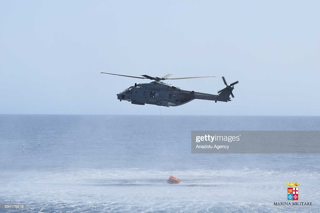 A helicopter is seen during the rescue operation of a capsized boat at Sicilian Strait, between Libya and Italy, in Mediterranean sea on May 25, 2016. The Italian Navy saved around 500 migrants as they found dead bodies of seven migrants in the sea during the operations.
