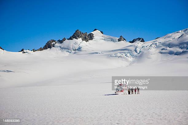 Helicopter landed on ice and snowfields.