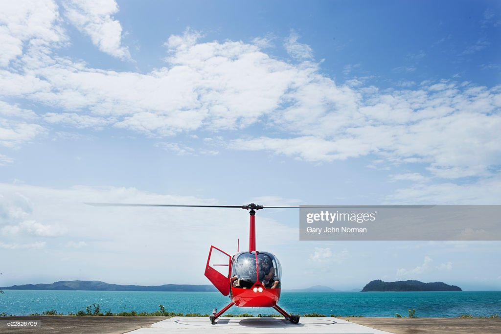 Helicopter landed on island.