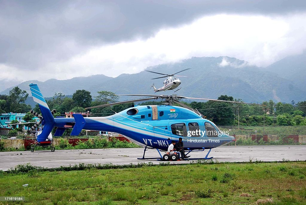 A Helicopter landing at Dehradun Helipad despite of bad weather on June 27, 2013 in Dehradun, India. Air rescue operations resumed today to pull out stranded people but they had to be halted for Badrinath as the weather turned bad, even as decaying bodies were being cremated swiftly in worst-hit Kedarnath Valley amid fears of an epidemic outbreak.