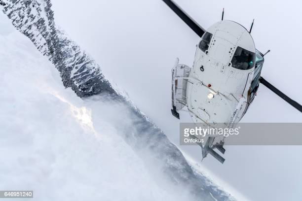 Helicopter Landing on Mountain Summit, Heli-Skiing