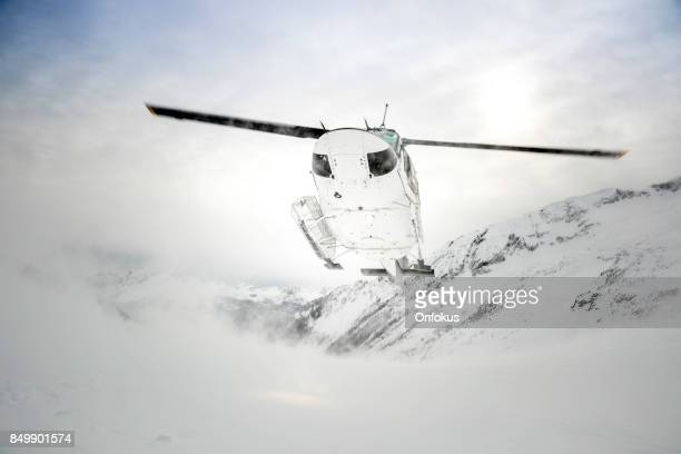 Helicopter Landing on Mountain Summit, Heli-Skiing