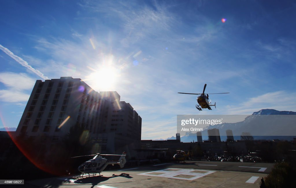 A helicopter lands outside the Grenoble University Hospital Centre where former German Formula One driver Michael Schumacher is being treated for a severe head injury following a skiing accident on Sunday in Meribel on December 31, 2013 in Grenoble, France.