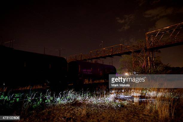 Helicopter lights illuminate the area near the wreckage of an Amtrak passenger train carrying more than 200 passengers from Washington DC to New York...