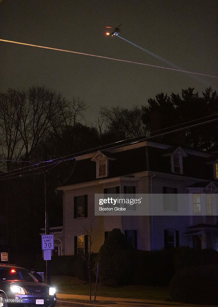 A helicopter lights up the scene where the second suspect was captured tonight. After an intense manhunt and two-hour standoff in Watertown, law enforcement took a person into custody believed to be related to the Boston Marathon bombings.