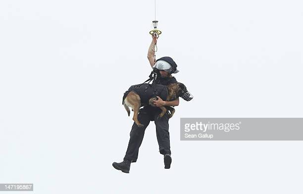 A helicopter of the Bundespolizei the German federal police force lifts a police officer and his dog during a demonstraiton of capabilities on June...