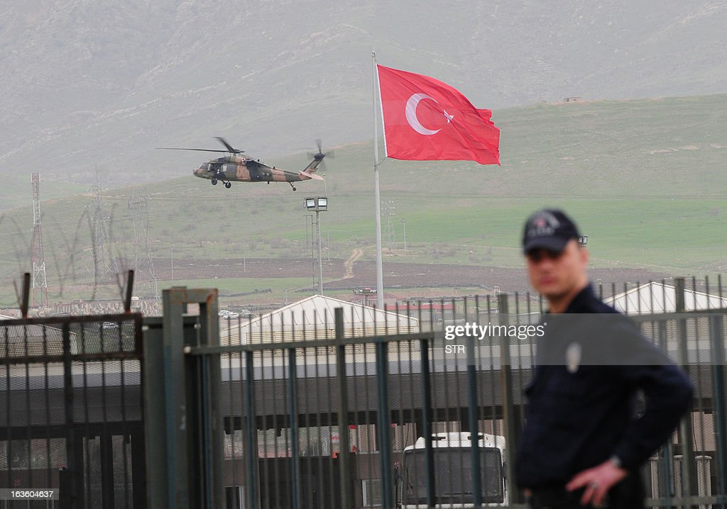 A helicopter of the Turkish army brings back Turkish prisoners over the Habur border crossing, in Sirnak, on the Turkish side, on March 13, 2013 after they were released by the Kurdish Workers' Party (PKK) in the northern Iraqi city of Dohuk, after being held for two years in northern Iraq, in response to a new peace push by Ankara to end a 29-year-old insurgency in southeast Turkey. Speaking during an official visit to Sweden, Turkish President Abdullah Gul said it was 'joyful' news that the eight were finally returning home from captivity in northern Iraq.