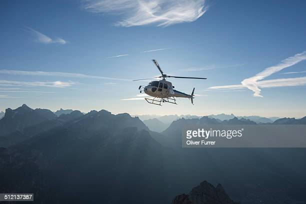 Helicopter on scenic flight at sunrise, Alleghe, Dolomites, Italy