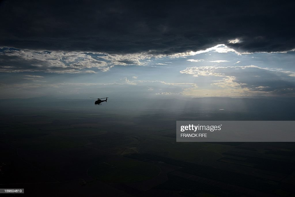 A helicopter overflies Tucuman before the Stage 9 of the Dakar 2013 between Tucuman and Cordoba, Argentina, on January 14, 2013. The rally takes place in Peru, Argentina and Chile between January 5 and 20. AFP PHOTO / FRANCK FIFE