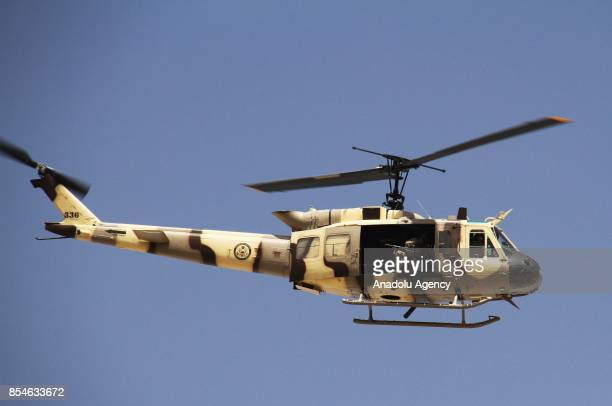 A helicopter patrols after militants carried out a rocket attack at Kabul International Airport in Kabul Afghanistan on September 27 2017