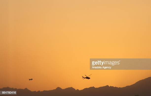 A helicopter patrols after suicide bombers attacked on Kabul International Airport in Kabul Afghanistan on September 27 2017 An Afghan woman was...