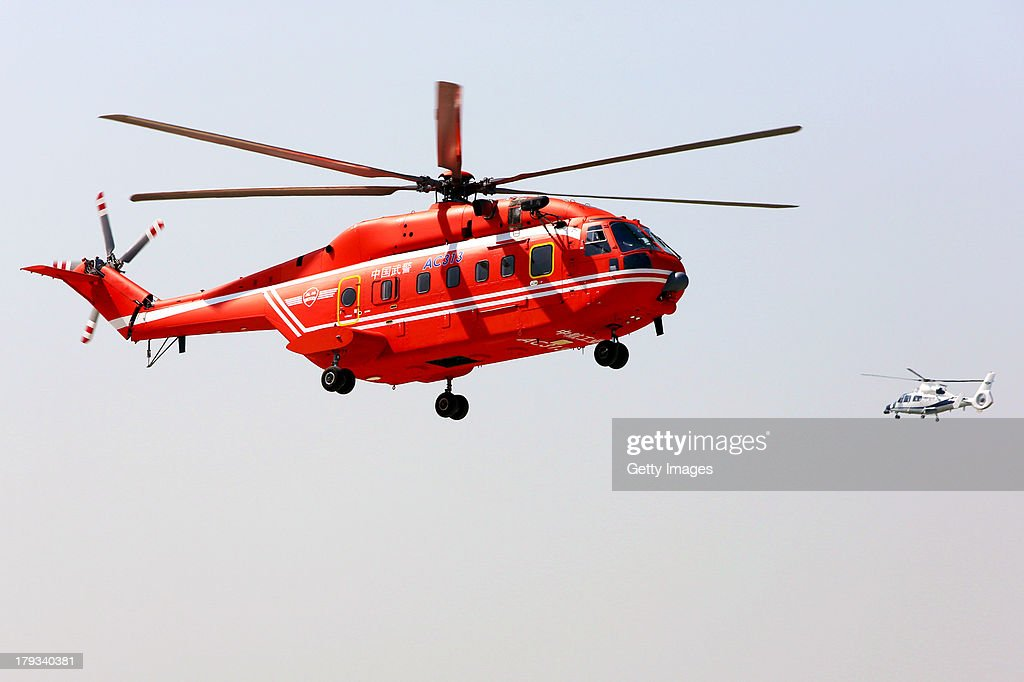 A helicopter performs during the 2nd China Helicopter Exhibition on September 1, 2013 in Tianjin, China. The 2nd China Helicopter Exhibition will be held from September 5 to 8.