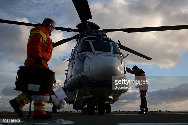 A helicopter pilot exits from the cockpit of a Bristow AS332 Super Puma helicopter on the Armada gas condensate platform operated by BG Group Plc in...