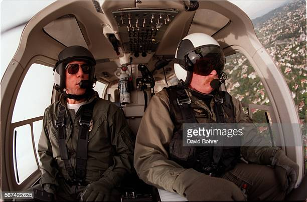 LAPD helicopter pilot/officer Mike Neveaux and tactical flight officer Matthew Jaroscak fly over a call in the city of LA in one of the new Bell 407...