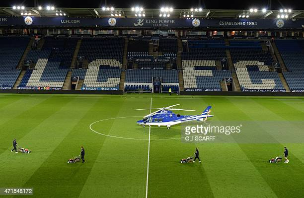 A helicopter reportedly owned by Vichai Srivaddhanaprabha the owner of Leicester City football club lands on the pitch after the English Premier...