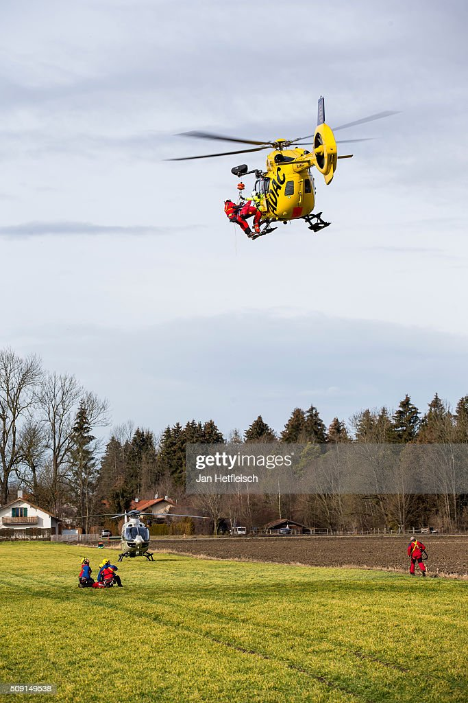 A helicopter rescues a casualty from the area after two trains collided head-on several hours before in Bavaria on February 9, 2016 near Bad Aibling, Germany. Germany. Authorities say at least nine people are dead and over 100 injured in the collision between two trains of the Meridian local commuter train service that occurred at approximately 7 am.