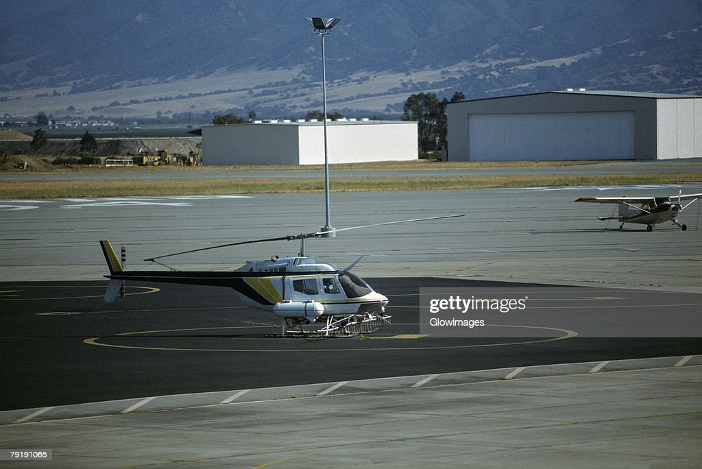 Helicopter rigged for aerial irrigation : Foto de stock