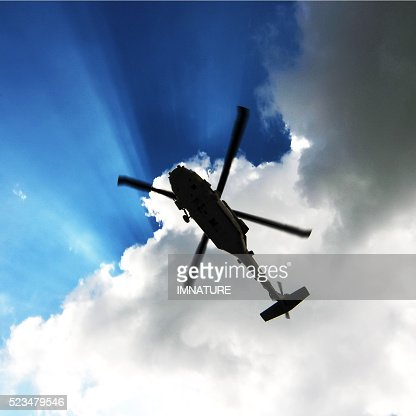 helicopter silhouette : Stock Photo
