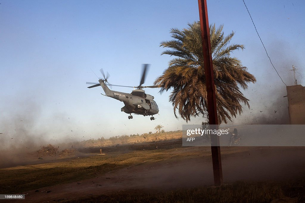 A helicopter takes off carrying French soldiers from various units of the Air Force, Ground Army (Armee de Terre) and the French Foreign Legion for a military operation in the north of Mali on January 21, 2013. The government of Mali late Monday extended a state of emergency in place since January 12 for three months amid a French-led military offensive to flush out Al Qaeda-linked Islamists from the north. AFP PHOTO / FABIO BUCCIARELLI