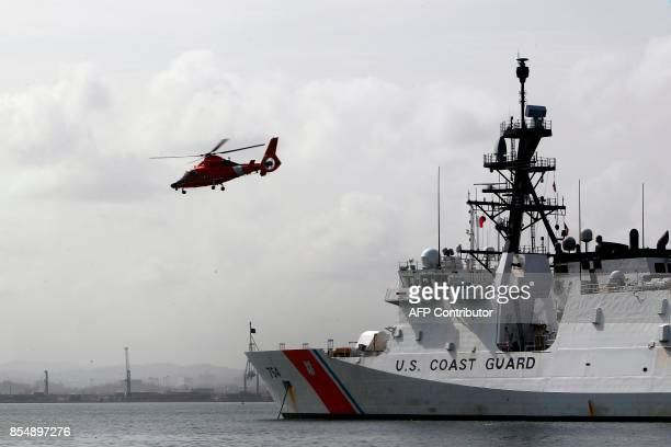A helicopter takes off from a US Coast Guard cutter one week after the passage of Hurricane Maria in San Juan Puerto Rico on September 27 2017 The US...