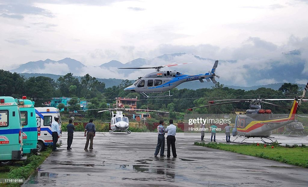 A Helicopter takes off from Dehradun Helipad despite of bad weather on June 27, 2013 in Dehradun, India. Air rescue operations resumed today to pull out stranded people but they had to be halted for Badrinath as the weather turned bad, even as decaying bodies were being cremated swiftly in worst-hit Kedarnath Valley amid fears of an epidemic outbreak.