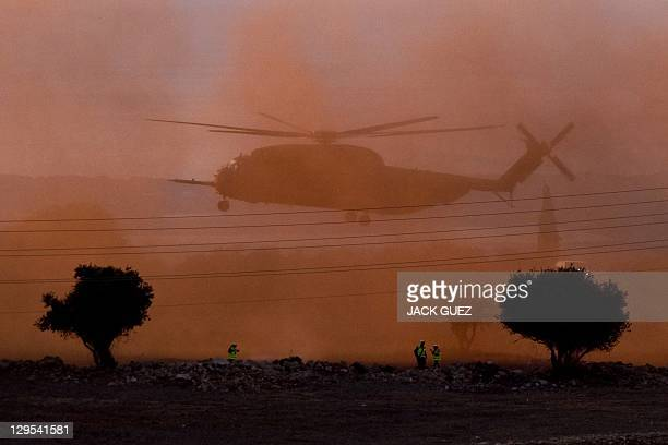 A helicopter transporting Israeli soldier Gilad Shalit and his family lands at their home town of Mitzpe Hila following a landmark deal with Hamas...