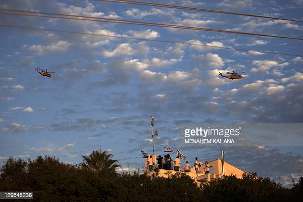 A helicopter transporting Israeli soldier Gilad Shalit and his family comes to lands at their home town of Mitzpe Hila following a landmark deal with...