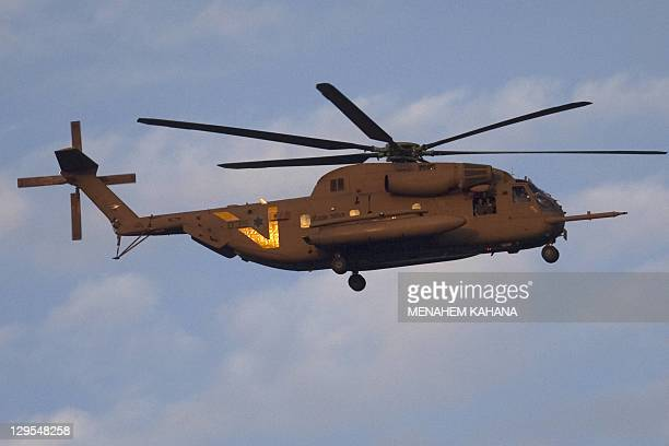 A helicopter transporting Israeli soldier Gilad Shalit and his family come to lands at their home town of Mitzpe Hila following a landmark deal with...