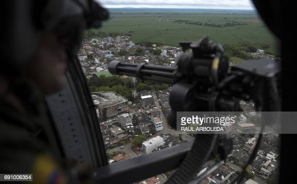 A helicopter used by Colombia's antinarcotics police to throw out pamphlets offering rewards for information leading to the capture of members of the...