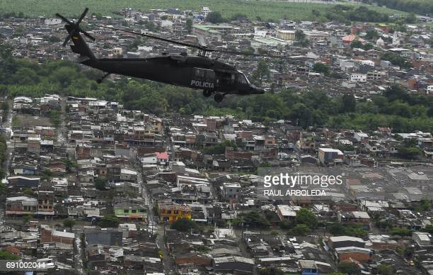 A helicopter used by Colombia's antinarcotics police to throw pamphlets offering rewards for information leading to the capture of members of the...