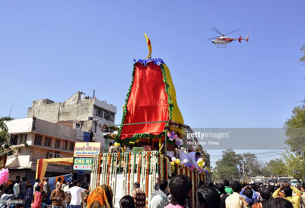 Helicopter was called to shower flower petals during Jagannath Rath Yatra celebrations at Navyug market on March 3, 2013 in Ghaziabad, India. Rath Yatra is the name of the massive Chariot Festival of Lord Jagannath- Baladeva- Subhadra, which is being celebrated with devotion and religious fervor in the holy land of Puri in Orrisa (now Odisha).