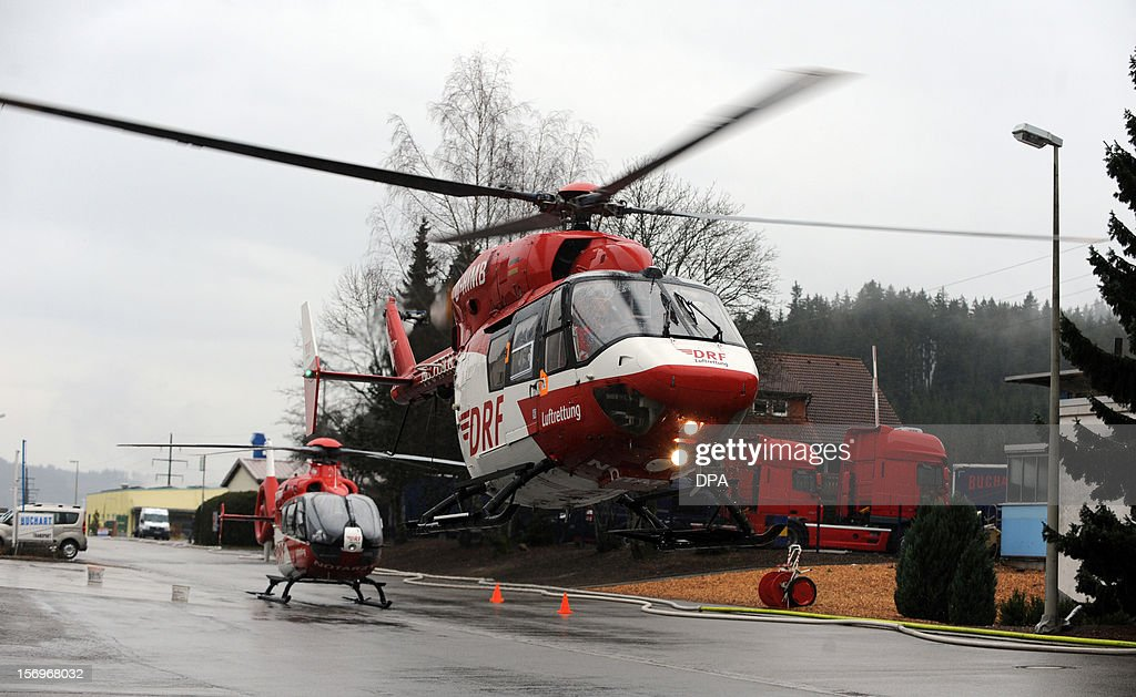 Helicopters evacuate the injured at the scene of a fire at a workshop for handicapped people in Titisee- Neustadt, southern Germany on November 26, 2012. Fourteen people died after a fire broke out.