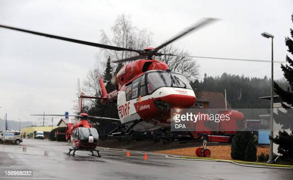 Helicopters evacuate the injured at the scene of a fire at a workshop for handicapped people in Titisee Neustadt southern Germany on November 26 2012...