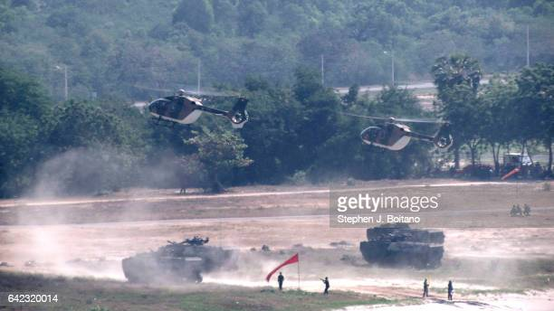 SATTAHIP CHONBURI THAILAND Helicopters land with an amphibious assault vehicles and secure the beach head during the ongoing USThai joint military...