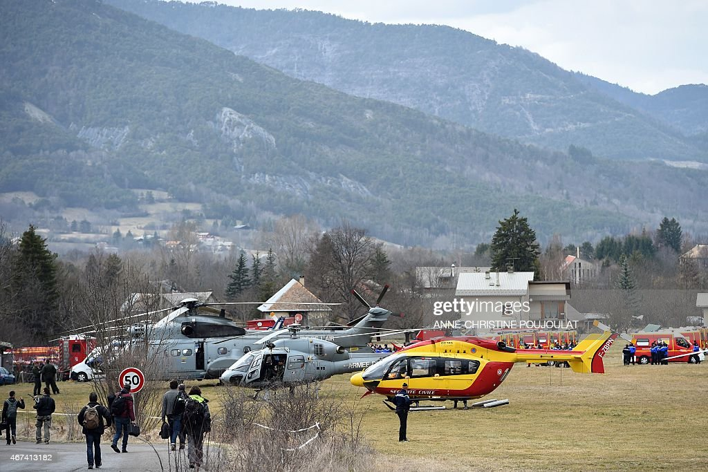 Helicopters of the French Air Force and civil security services are seen in Seyne southeastern France on March 24 near the site where a Germanwings...
