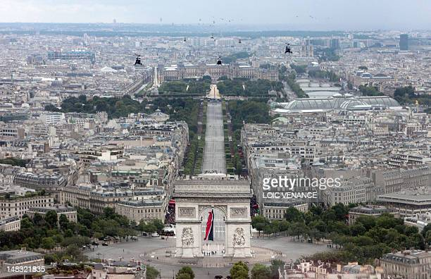 Helicopters of the French army flies over Paris on July 14 2012 during the Bastille Day traditional military parade on the ChampsElysees avenue...