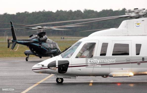 Helicopters prepare to depart the East Hampton Airport in East Hampton New York on Aug 13 2007