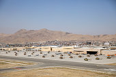 Helicopters sit on the tarmac at Kabul Airport on October 3 2014 in Kabul Afghanistan David Cameron is the first world leader to meet Afghanistan's...