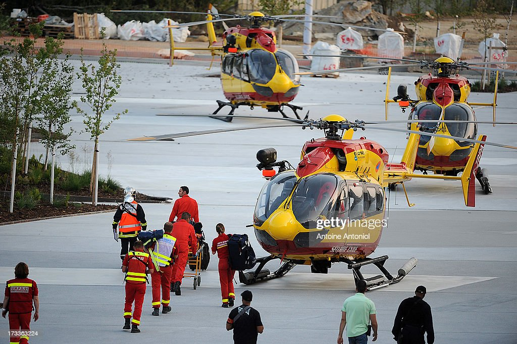 Helicopters stand ready to evacuate injured passengers outside the railway station after a train accident on July 12, 2013 in Bretigny-sur-Orge, France. An intercity train carring 385 passengers, travelling from Paris towards Limoges, derailed crashing into a station platform leaving six people dead and a further 26 injured.