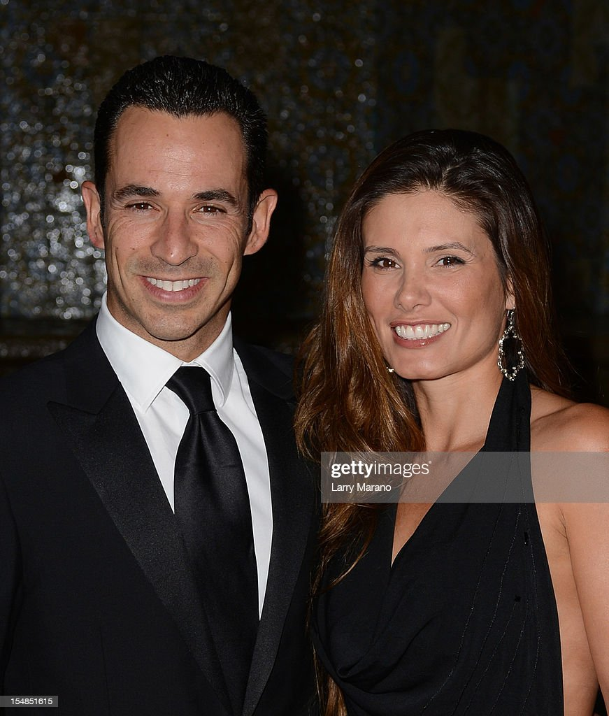 <a gi-track='captionPersonalityLinkClicked' href=/galleries/search?phrase=Helio+Castroneves&family=editorial&specificpeople=201776 ng-click='$event.stopPropagation()'>Helio Castroneves</a> and Adriana Henao arrive at 23rd Annual Chris Evert/Raymond James Pro-Celebrity Tennis Classic Gala at Boca Raton Resort on October 27, 2012 in Boca Raton, Florida.